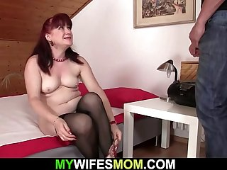 Brunette motherinlaw taking his cock from behind