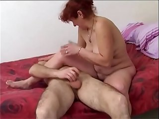 Thoughtful mom gives a blowjob to her son