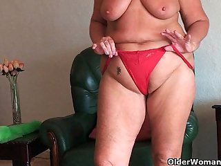 Chubby granny with saggy big tits and plump ass spreads pussy