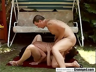 Garden threesome with an older woman