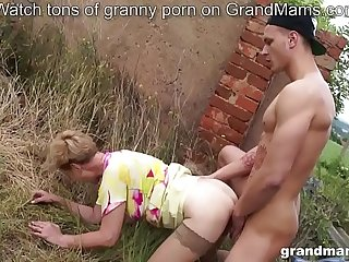 Old busty granny fucks and SUCKS the bad youngster
