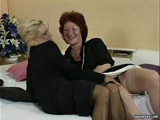 Granny fucks her lesbian friend's pussy with strapon