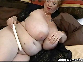 Fat granny Dagny with her big tits plays with vibrator